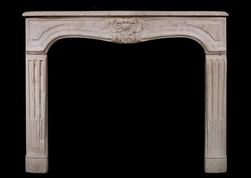 An 18th century French Louis XV limestone fireplace
