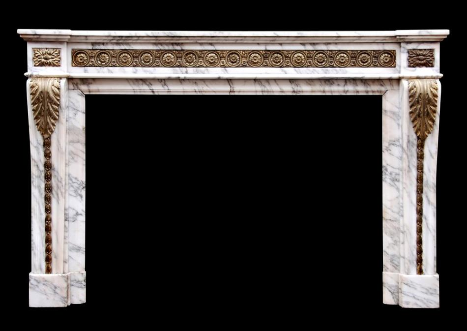 A Louis XVI style Arabescato marble fireplace with brass ormolu enrichments
