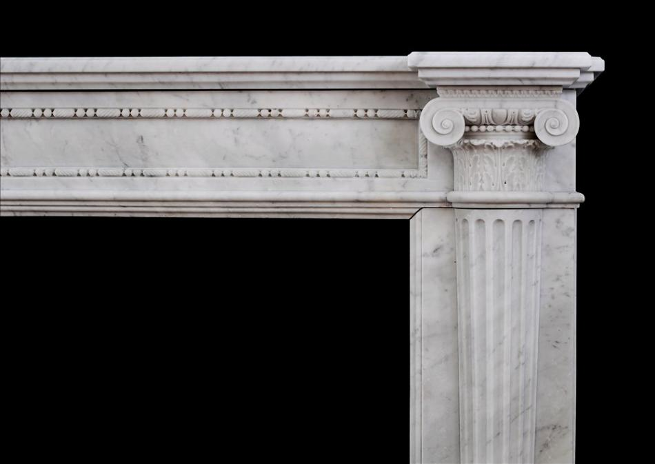 A very finely carved French Louis XVI mantlepiece in Carrara marble