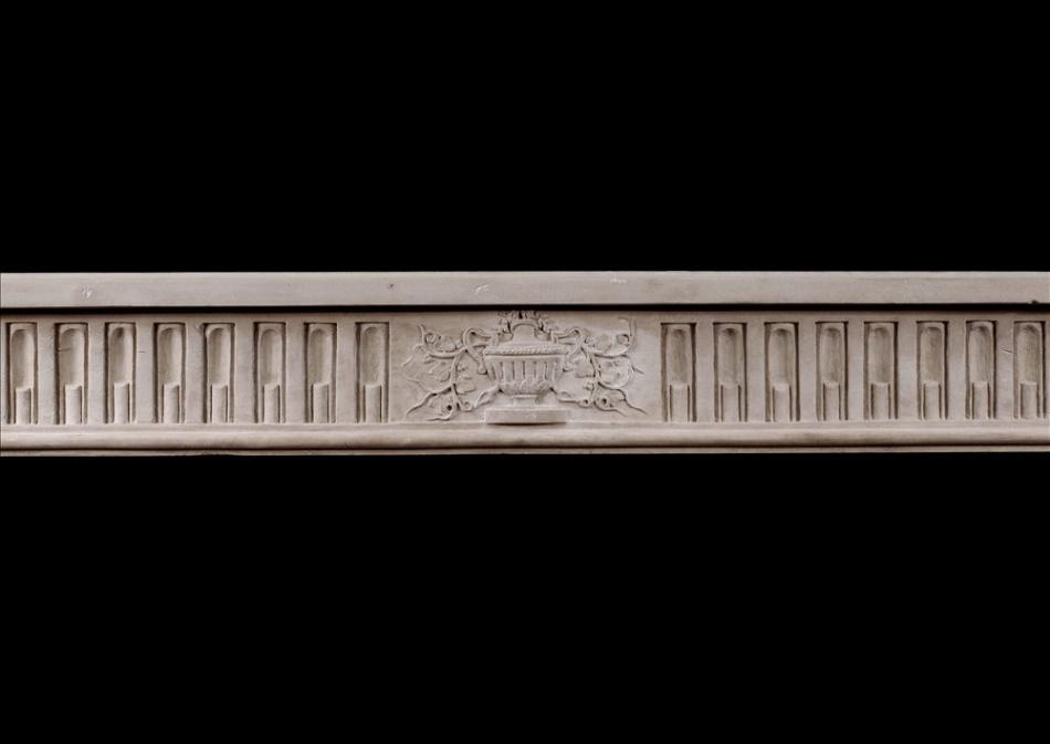 A fine quality period French Louis XVI style limestone fireplace