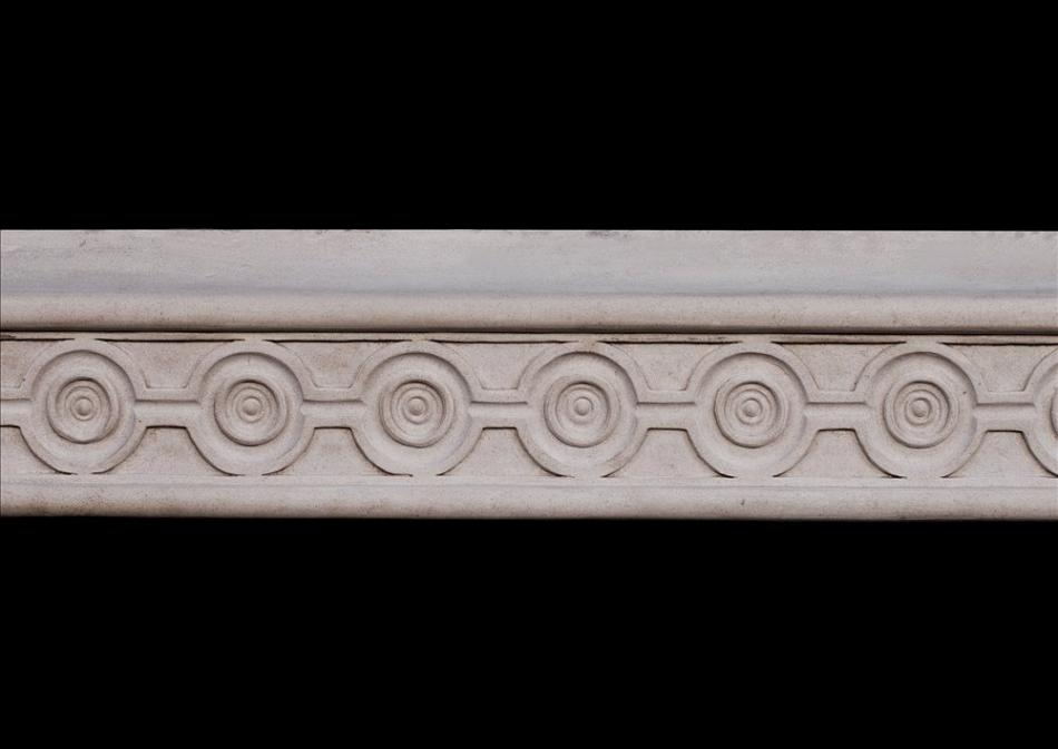 An attractive English limestone fireplace with guilloche carving