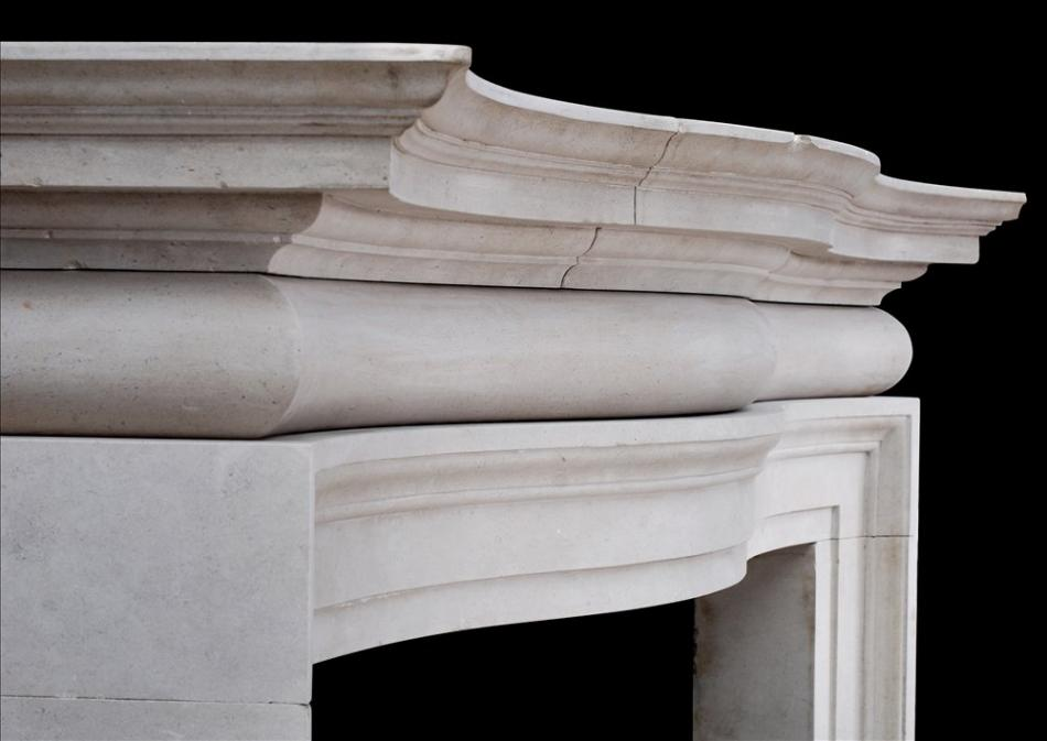 A large and imposing English Portland stone fireplace