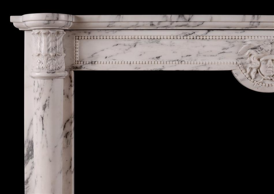 An antique French Louis XVI style fireplace in veined Statuary marble