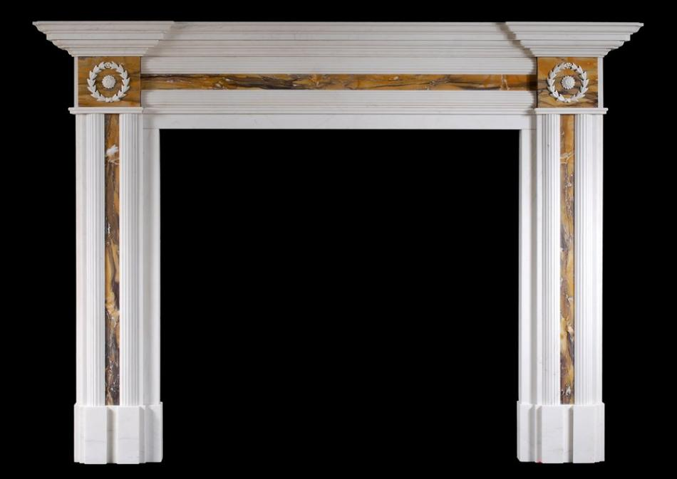 An English Regency style fireplace in white marble with Siena inlay
