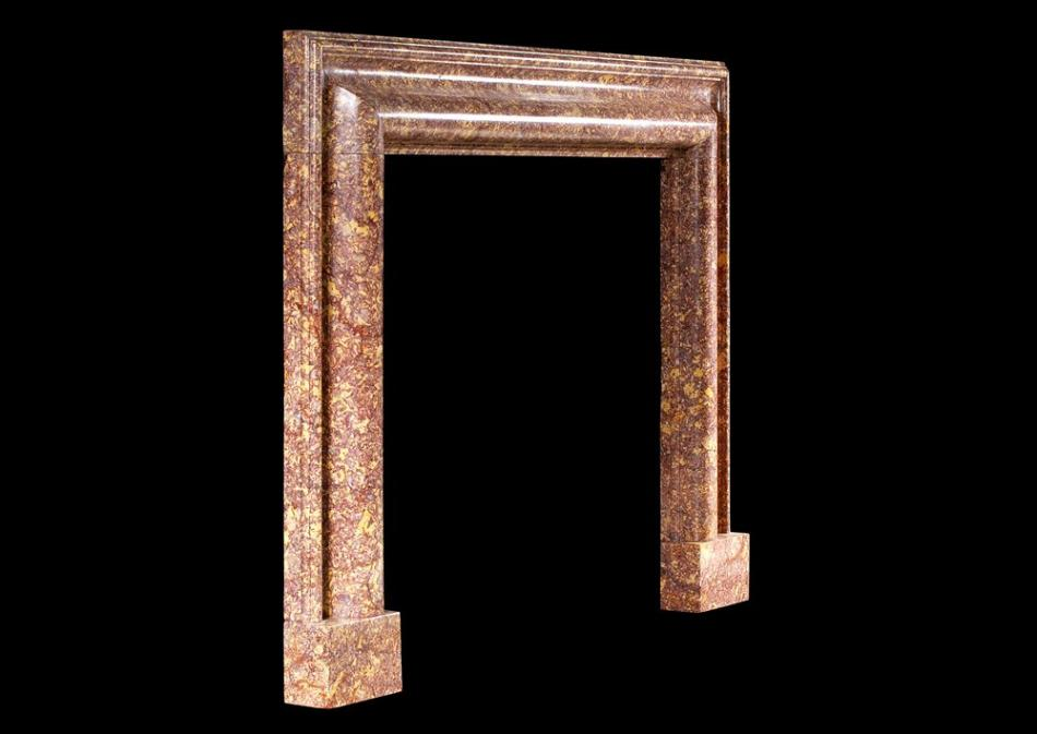 A 19th century English marble bolection fireplace