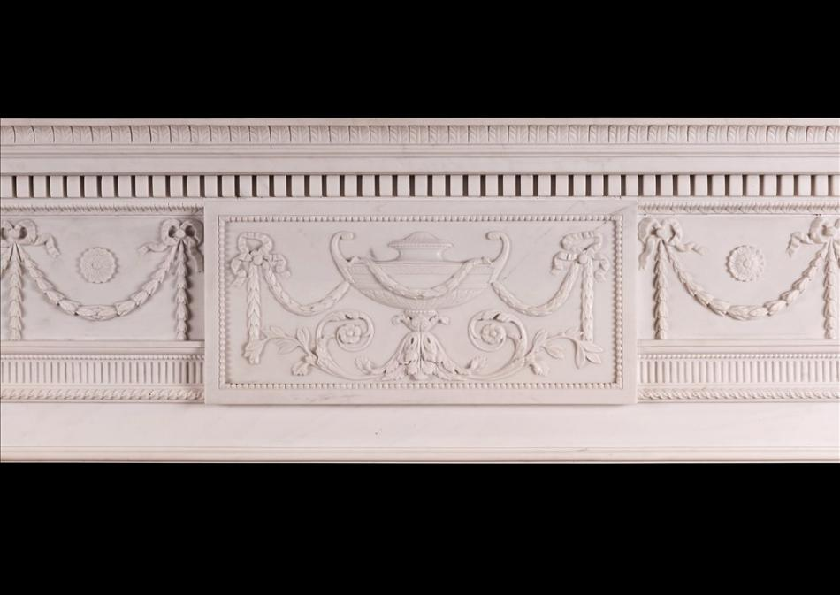 A white marble fireplace in the manner of Robert Adam