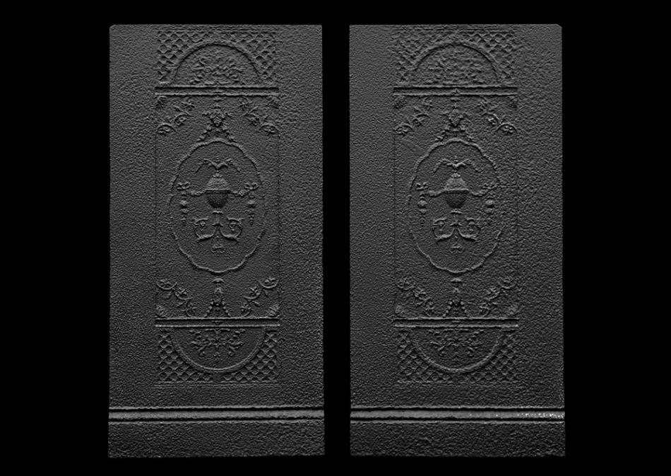 A pair of decorative cast iron interiors panels