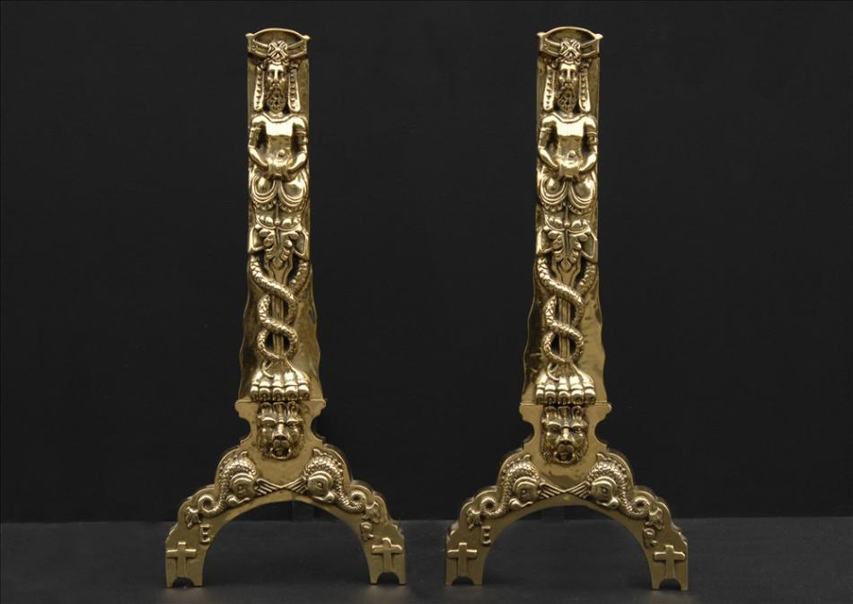 A large pair of decorative firedogs in the 17th century style