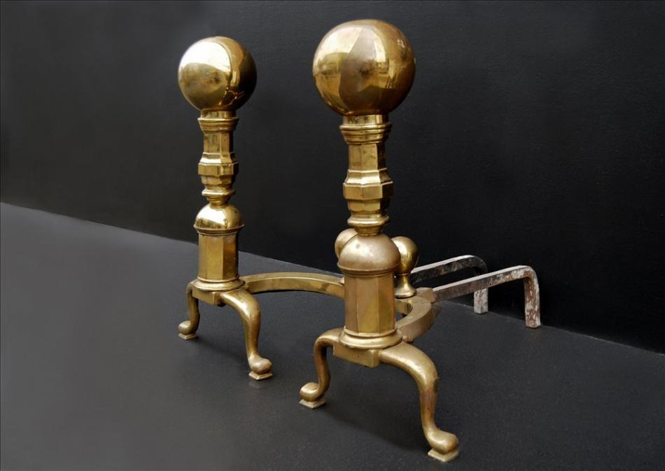 A very large and impressive pair of brass firedogs with ball tops