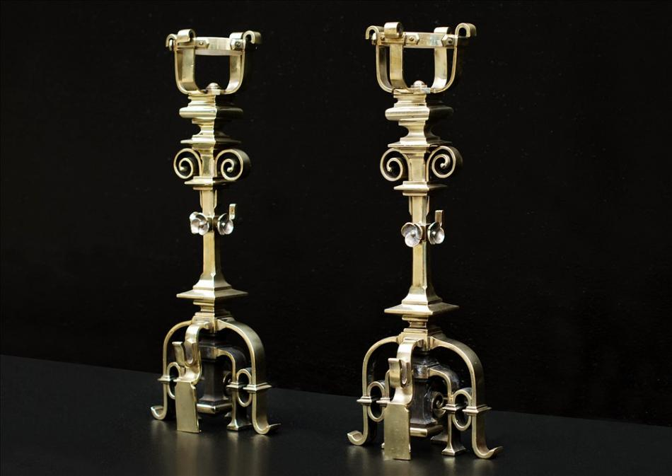 A pair of fine quality French Gothic Revival brass chenets
