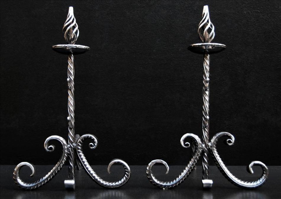 A pair of Arts and Crafts steel firedogs