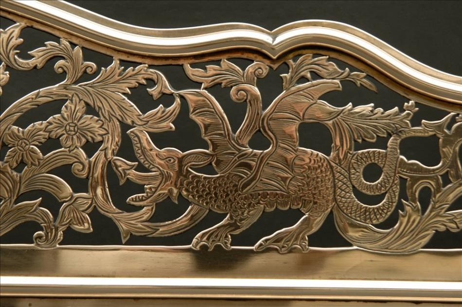A fine quality late 18th century brass fender with dragons and foliage