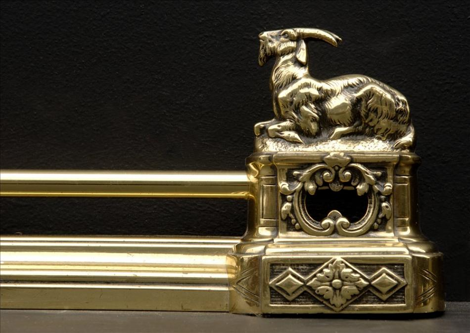 A brass french fender with goats to ends