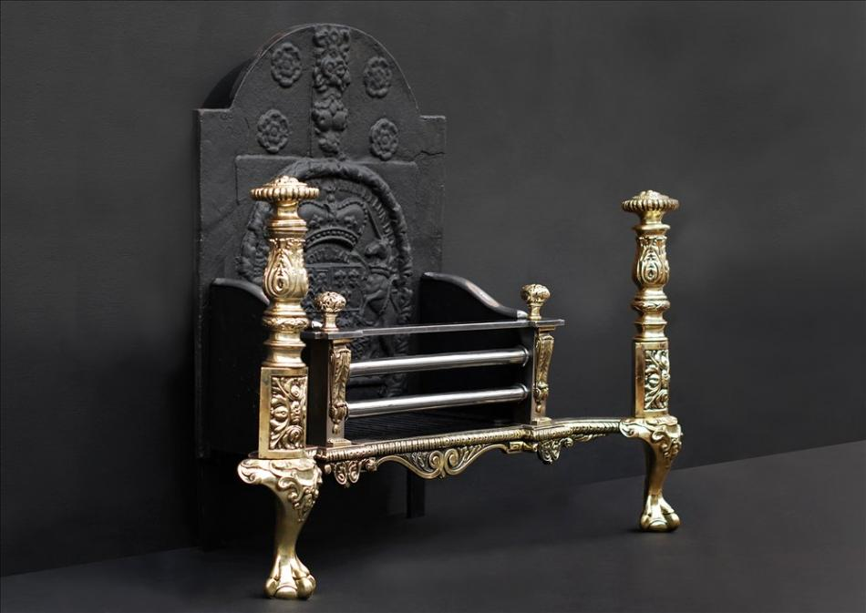 An impressive brass and steel fire grate