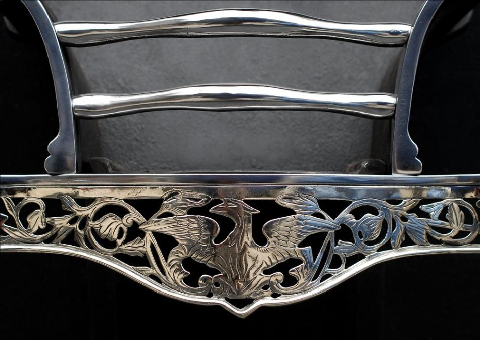 A nicely engraved steel and nickel firebasket
