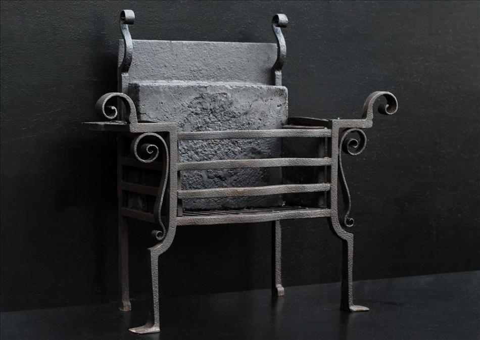 An unusual scrolled wrought iron firegrate