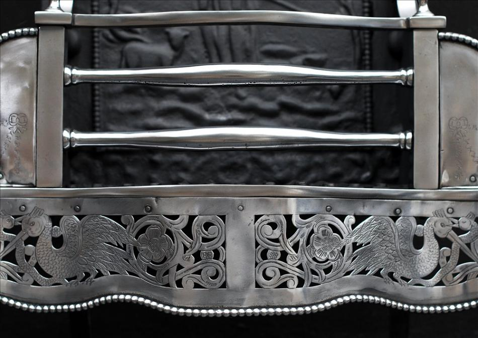 A George III style polished steel firegrate