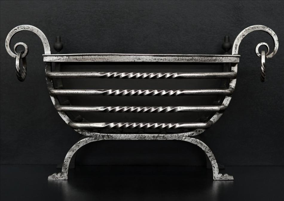An Arts and Crafts wrought iron firebasket