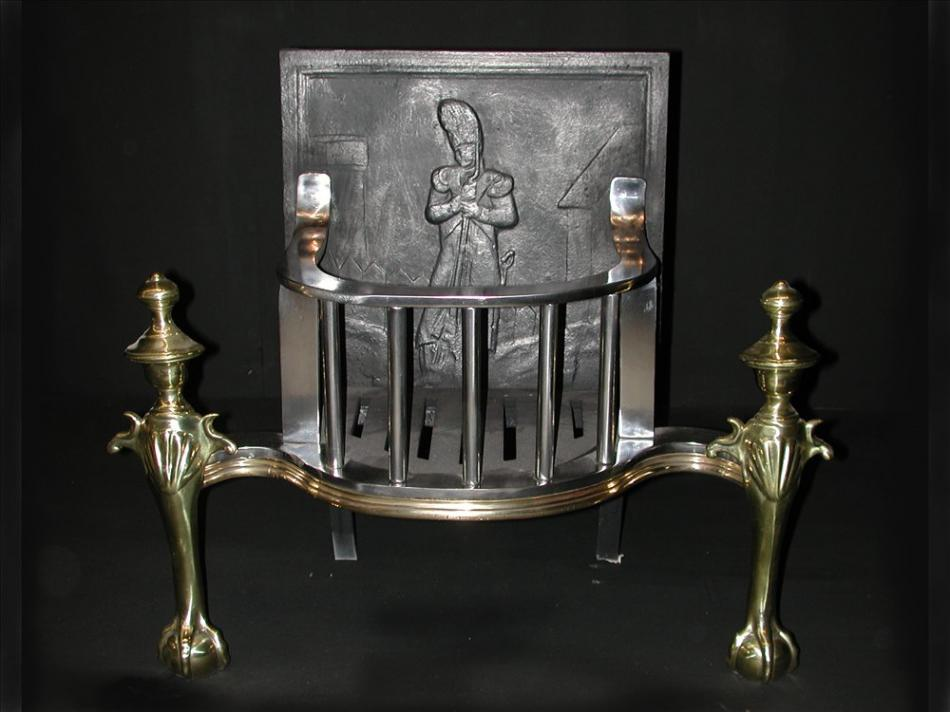 A 19th century Dutch brass and steel firegrate