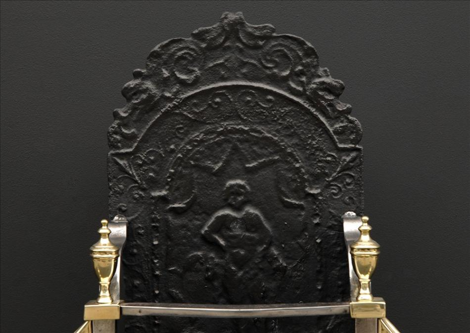 An early 19th century Georgian brass and antique steel engraved firegrate