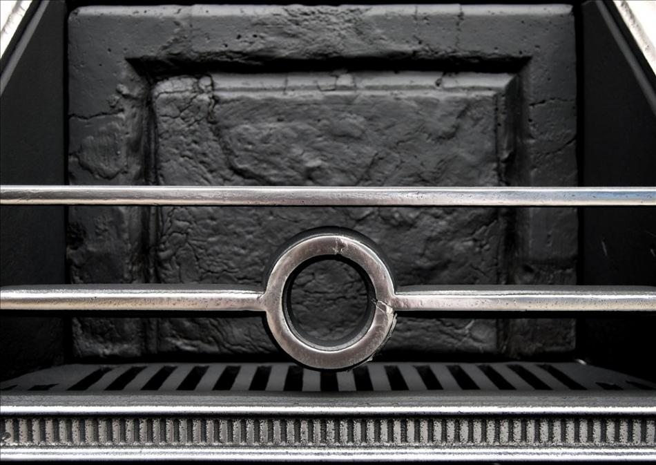 A mid 19th century Gothic style antique steel firegrate