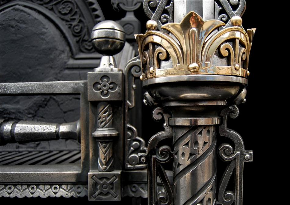 An impressive Gothic revival brass and polished iron firegrate