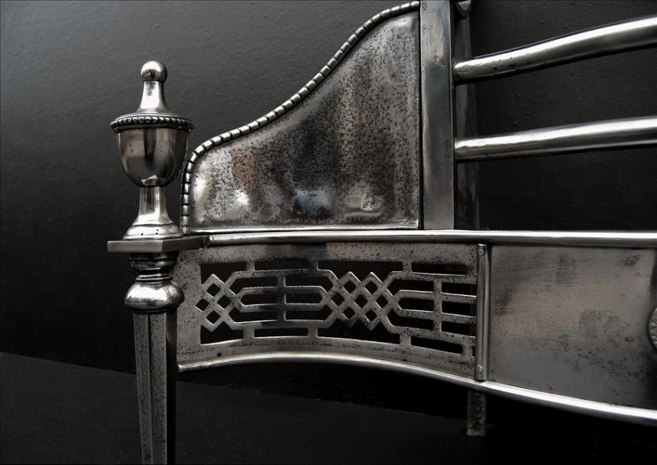 A Georgian style polished steel firegrate - 29.25 inch