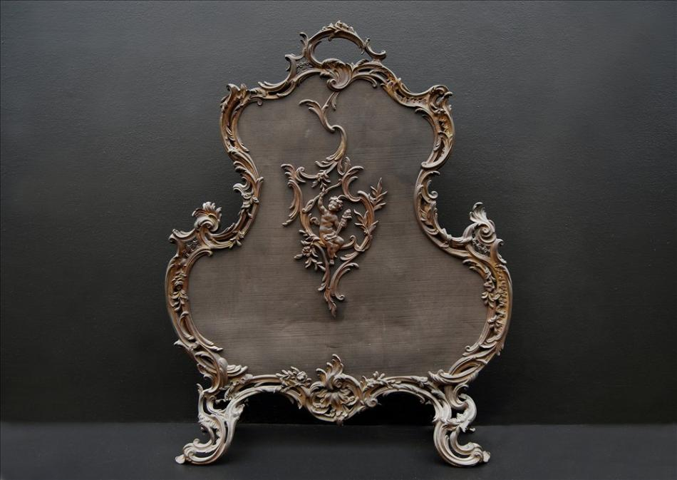 A French Louis XV style brass firescreen