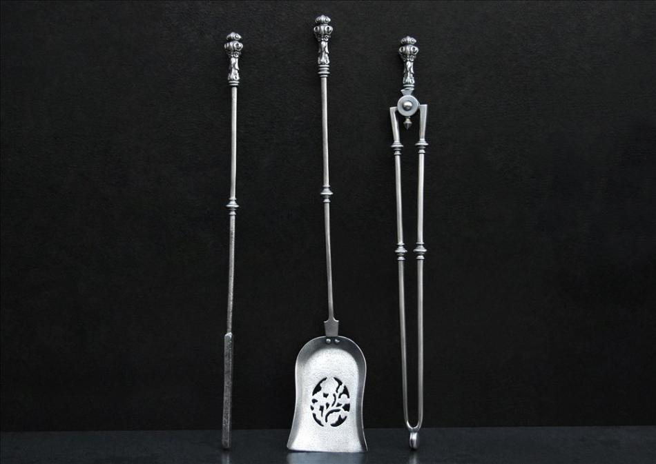 A set of 19th century steel firetools with pierced shovel