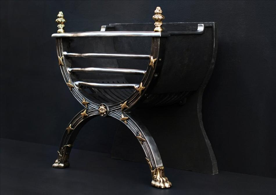 A elegant Regency style polished cast iron and brass firegrate