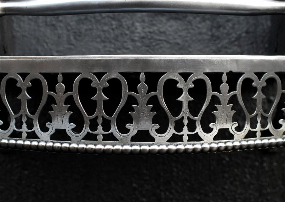 An attractive Queen Anne style polished steel firegrate
