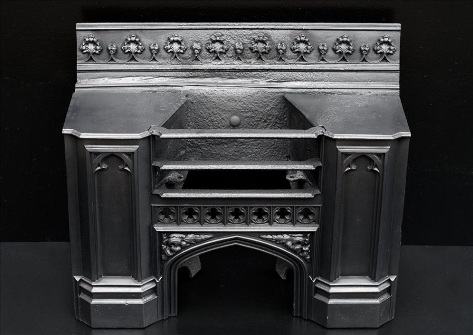A 19th century cast iron hob grate in the Gothic style