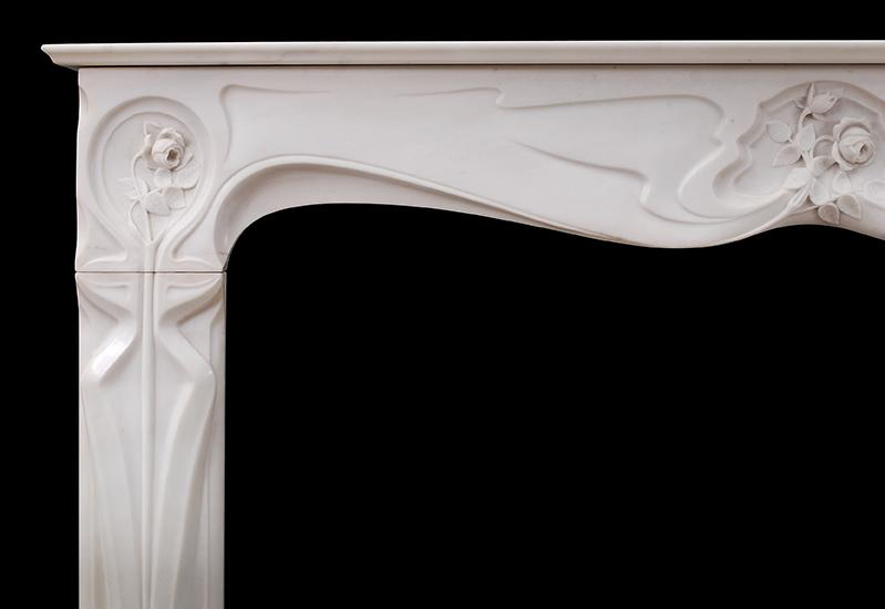 A refined French Art Nouveau white Statuary marble fireplace