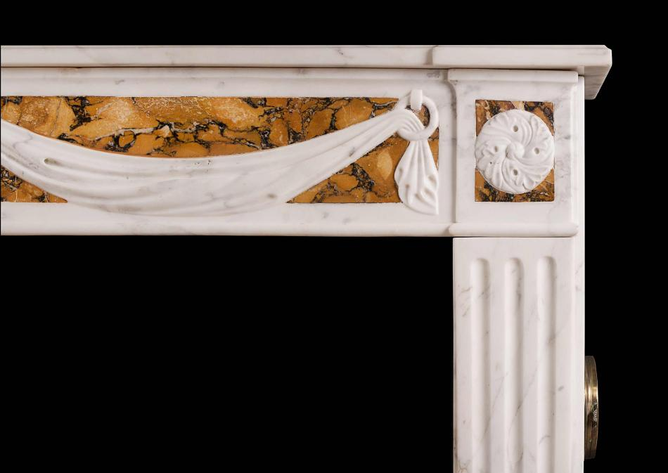 A French Louis XVI style fireplace in Statuary and Siena marble