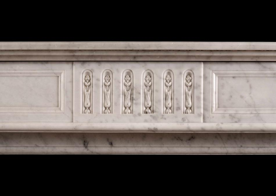 A Louis XVI style fireplace in Carrara marble