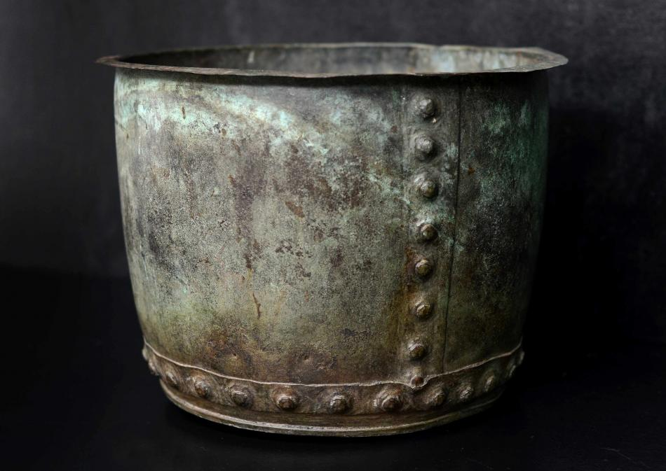 A large copper coal bucket with verdegris patination