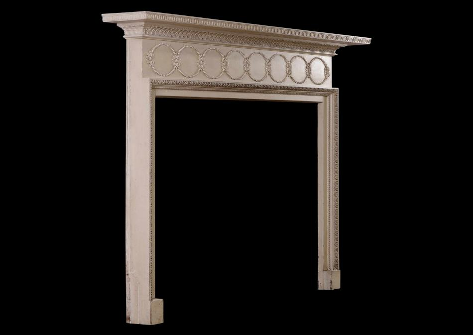 A fine quality painted pine and gesso fireplace