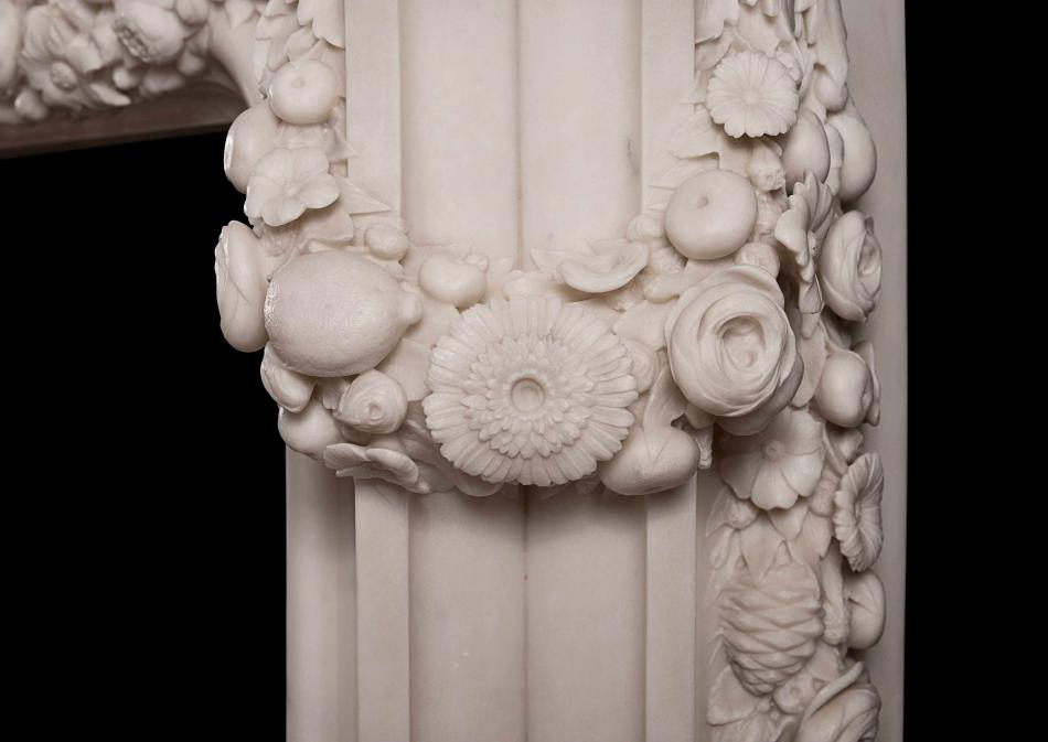 An ornately carved Italian Statuary marble fireplace