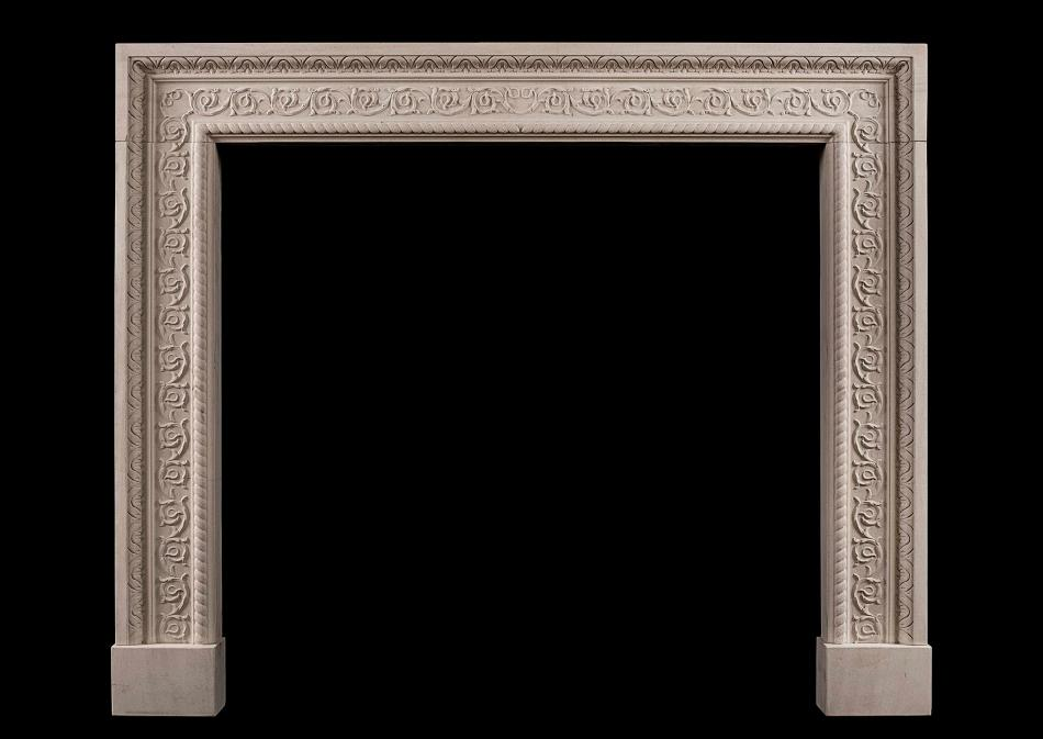 A carved English stone Fireplace with scrolled detailing