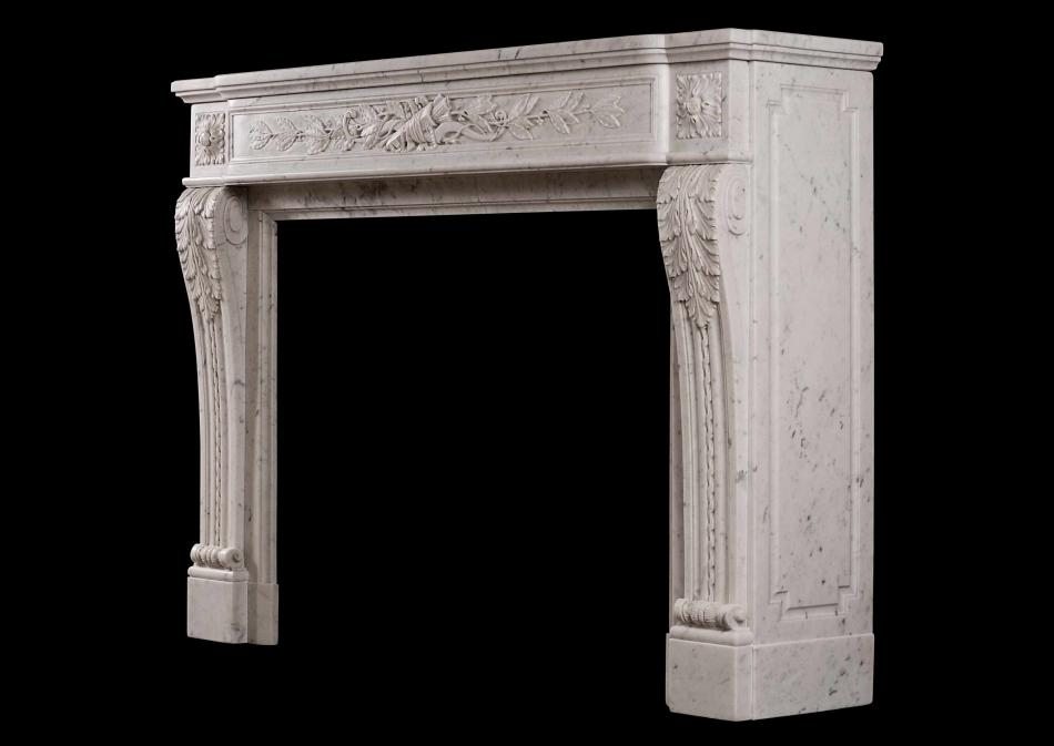 A Louis XVI style French antique fireplace in Carrara marble