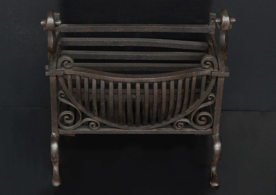 A late 19th century wrought iron firebasket