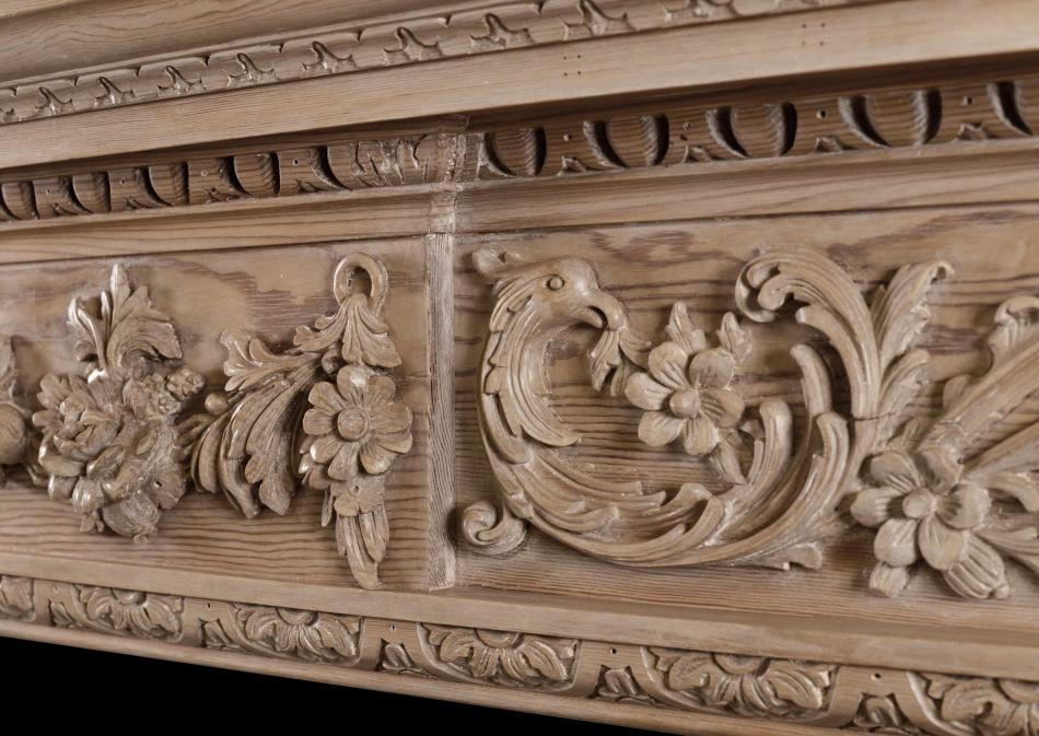 A Georgian style carved pine fireplace
