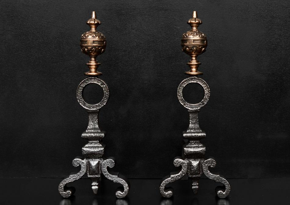 A pair of bronze and cast iron firedogs in the Baroque style