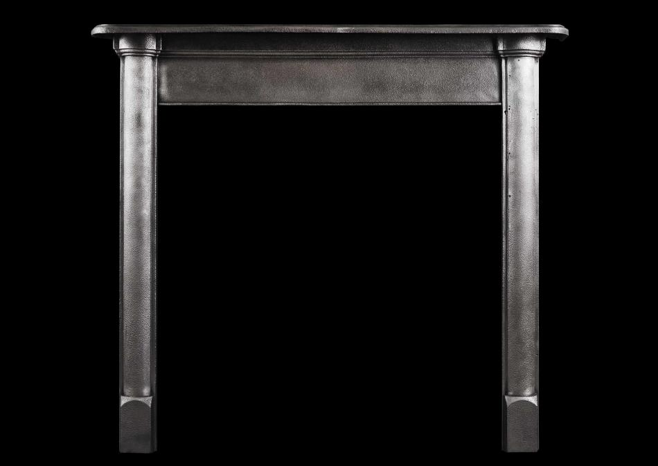 A simple polished cast iron fireplace