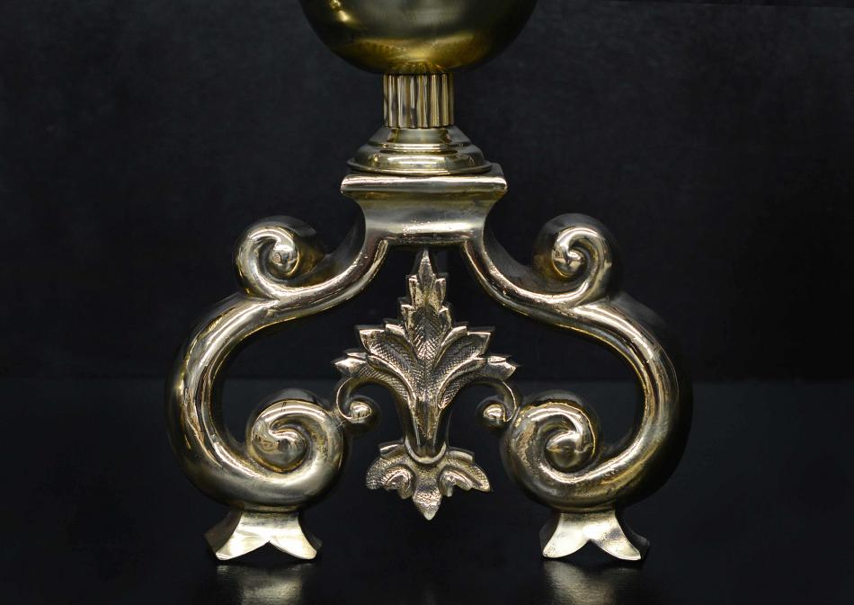 A substantial pair of English brass firedogs
