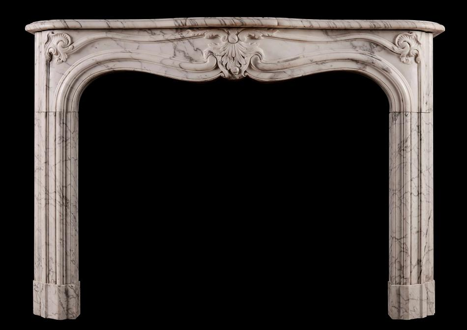 A French marble fireplace in the Rococo manner