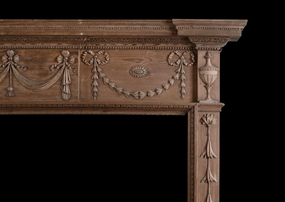 A carved pine fireplace in the Georgian style
