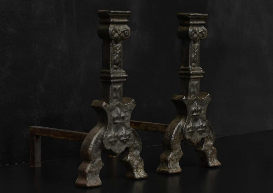 A pair or cast iron firedogs