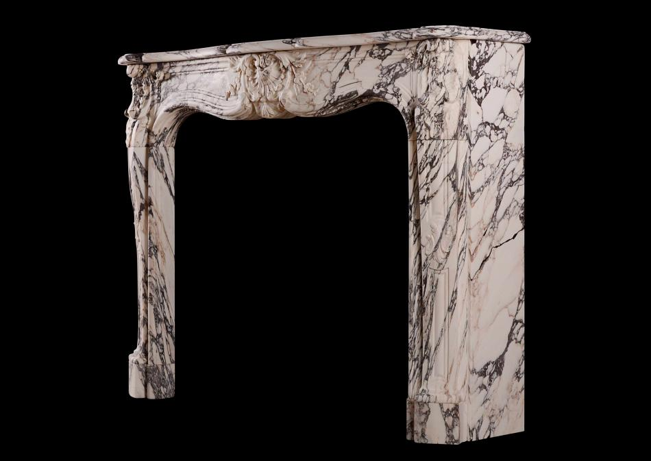 A beautiful Louis XV Breche Violette antique marble fireplace