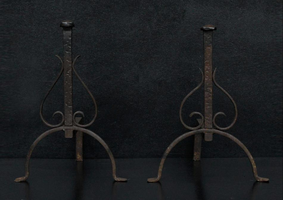 A set of wrought iron firedogs